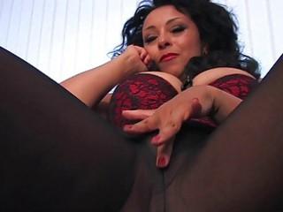 horny black haired woman inside dark stockings