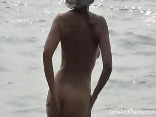 voyeur gangbangs hot mature babe on the sea coast
