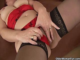 lewd granny in stockings is masturbating her