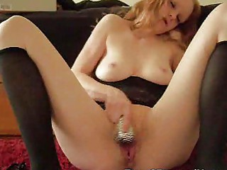 one woman having joy with shiny vibrator