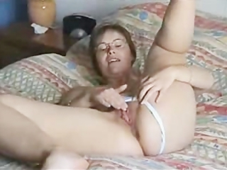 muff rubbing woman on bedstead