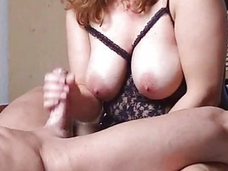chubby and busty young lady copulates with handjob