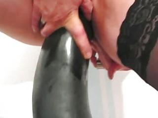frustrated woman fucking gigantic dildos