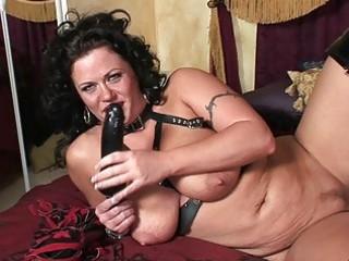 desperate brunette woman inside busty latex