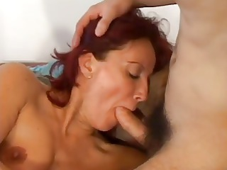 red-haired whore is shared by two stud cock