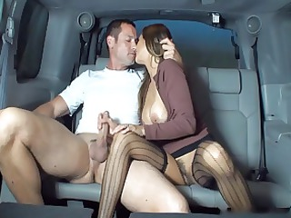 wife gives handjob inside backseat