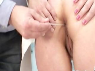 older  babe examined at the doctors