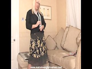 plump pale lady with large tits exposes and