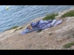 my woman sleeping at the seaside