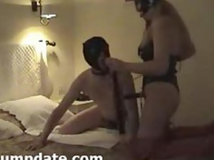 woman having on strapon and her hubby licks it